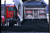 SJ-R: A semi-load of coal from Elkhart is dumped in the coal intake area at City Water, Light and Power in 2013.
